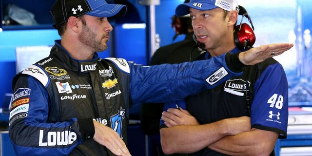 LONG POND, PA - JUNE 06: Jimmie Johnson, driver of the #48 Lowe's/Jimmie Johnson Foundation Chevrolet, left, talks with crew chief Chad Knaus in the garage area during practice for the NASCAR Sprint Cup Series Axalta 'We Paint Winners' 400 at Pocono Raceway on June 6, 2015 in Long Pond, Pennsylvania. (Photo by Nick Laham/Getty Images)