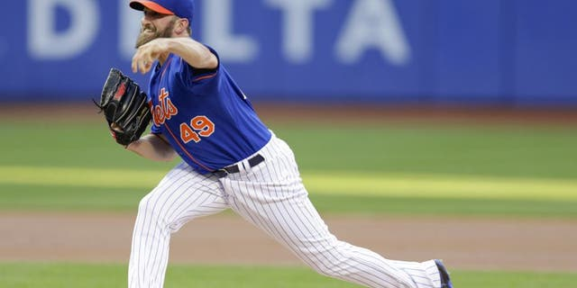 New York Mets' Jonathon Niese delivers a pitch during the first inning of a baseball game against the Los Angeles Dodgers on Friday, July 24, 2015, in New York. (AP Photo/Frank Franklin II)