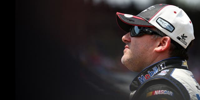 INDIANAPOLIS, IN - JULY 25: Tony Stewart, driver of the #14 Mobil 1/Bass Pro Shops Chevrolet, looks on during qualifying for the NASCAR Sprint Cup Series Crown Royal Presents the Jeff Kyle 400 at the Brickyard at Indianapolis Motor Speedway on July 25, 2015 in Indianapolis, Indiana. (Photo by Sarah Crabill/NASCAR via Getty Images)