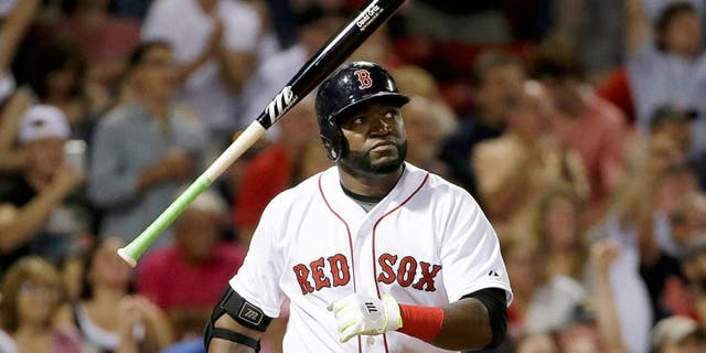 Boston Red Sox's David Ortiz tosses the bat as he watches the flight of his three-run home run in the fifth inning of a baseball game against the Detroit Tigers at Fenway Park, Sunday, July 26, 2015, in Boston. Ortiz homered twice and drove in a career-high seven runs to lead the Red Sox to an 11-1 victory. (AP Photo/Steven Senne)