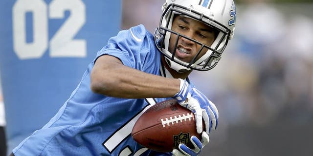 Detroit Lions wide receiver Golden Tate catches a pass during NFL football training camp in Allen Park, Mich., Monday, July 28, 2014. (AP Photo/Paul Sancya)