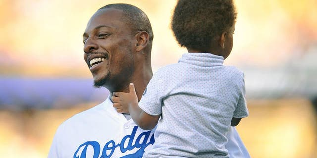 July 28, 2015; Los Angeles, CA, USA; Los Angeles Clippers forward Paul Pierce in attendance with son Prince before the Los Angeles Dodgers play against the Oakland Athletics at Dodger Stadium. Mandatory Credit: Gary A. Vasquez-USA TODAY Sports