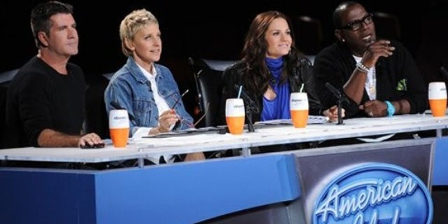 "In this undated publicity image released by Fox, ""American Idol"" judges, from left, Simon Cowell,  Ellen DeGeneres, Kara DioGuardi and Randy Jackson are shown."