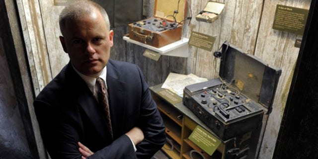 July 28: Mark Stout, a historian at the International Spy Museum, stands near spy radios used during World War II and the Cold War. Stout is an expert on one of America's most secretive espionage agencies, known simply as the Pond.