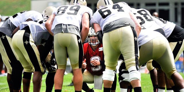 Jul 28, 2014; White Sulpher Springs, WV, USA; New Orleans Saints quarterback Drew Brees (9) huddles with the offense during training camp at The Greenbrier. Mandatory Credit: Michael Shroyer-USA TODAY Sports