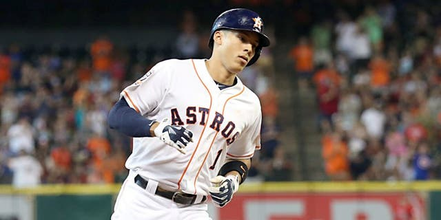 Jul 28, 2015; Houston, TX, USA; Houston Astros shortstop Carlos Correa (1) rounds the bases after hitting a home run against the Los Angeles Angels in the first inning at Minute Maid Park. Mandatory Credit: Thomas B. Shea-USA TODAY Sports