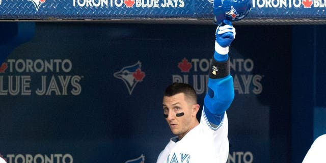 Toronto Blue Jays' Troy Tulowitzki tips his helmet after hitting a two-run home run during the third inning of a baseball game against the Philadelphia Phillies, Wednesday, July 29, 2015, in Toronto. (Darren Calabrese/The Canadian Press via AP) MANDATORY CREDIT
