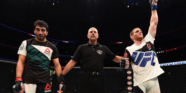 CHICAGO, IL - JULY 25: Andrew Holbrook (R) reacts after his split-decision victory over Ramsey Nijem in their lightweight bout during the UFC event at the United Center on July 25, 2015 in Chicago, Illinois. (Photo by Jeff Bottari/Zuffa LLC/Zuffa LLC via Getty Images)