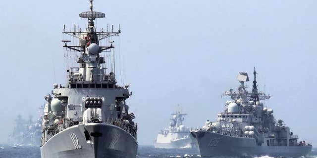 """In this May 24, 2014, file photo, China's Harbin (112) guided missile destroyer and DDG-139 Ningbo Sovremenny class Type-956EM destroyer, right, take part in a week-long China-Russia """"Joint Sea-2014"""" navy exercise at the East China Sea off Shanghai, China. A Chinese navy task force wrapped up visits to four Persian Gulf states as the increasingly capable maritime force grows its presence in the strategically vital region. The three ships, including Harbin, departed Kuwait on Sunday, Feb. 5, 2017, after stopping in Saudi Arabia, Qatar and the United Arab Emirates, the Defense Ministry said on its website Monday, Feb. 6, 2017. (Chinatopix via AP)"""