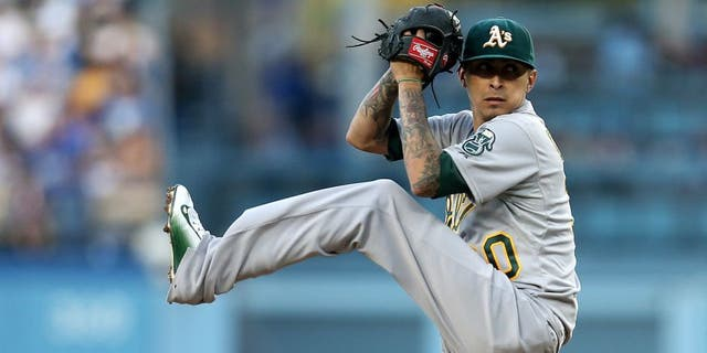 LOS ANGELES, CA - JULY 29: Jesse Chavz #30 of the Oakland Athletics throws a pitch against the Los Angeles Dodgers at Dodger Stadium on July 29, 2015 in Los Angeles, California. (Photo by Stephen Dunn/Getty Images)