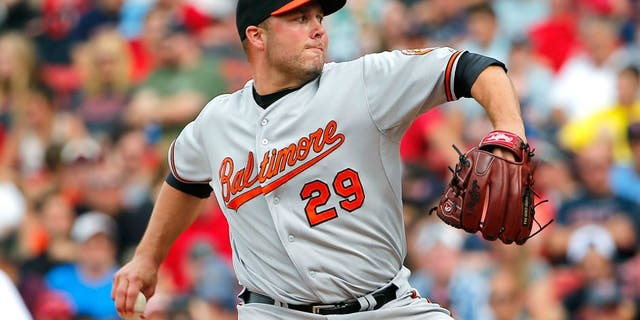 BOSTON, MA - JUNE 25: Tommy Hunter #29 of the Baltimore Orioles pitches against the Boston Red Sox during the ninth inning in a game at Fenway Park on June 25, 2015 in Boston, Massachusetts. (Photo by Winslow Townson/Getty Images)