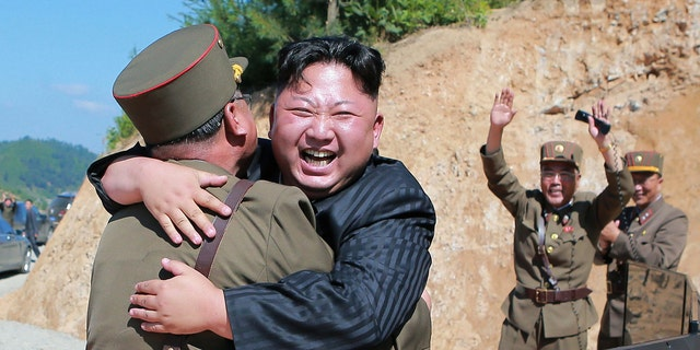 North Korean leader Kim Jong Un hugs a member of the military after a successful intercontinental ballistic missile test flight.
