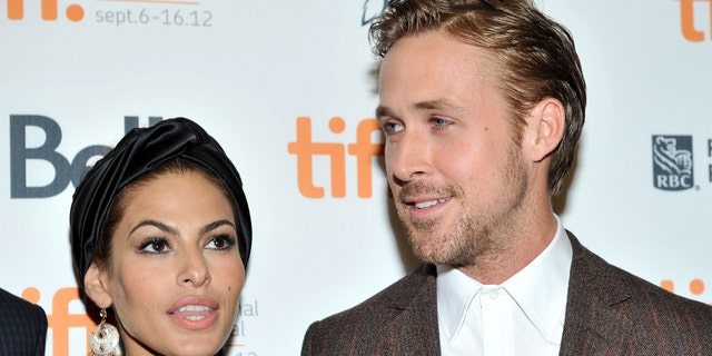 Actors (L-R) Eva Mendes and Ryan Gosling attend