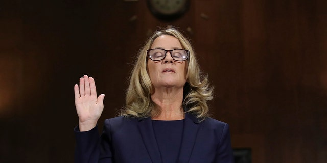 Christine Blasey Ford is sworn in before the Senate Judiciary Committee, Thursday, Sept. 27, 2018, in Washington. (Win McNamee/Pool Image via AP)