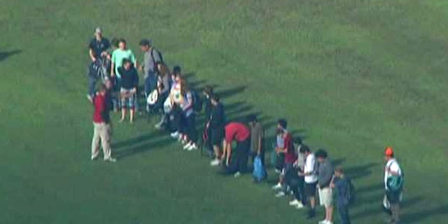 Students were evacuated from the school following the school shooting.