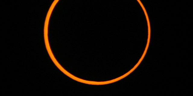The moon passes between the earth and the sun to cause an annular solar eclipse as seen from Segovia in central Spain October 3, 2005. An annular eclipse differs from a total eclipse in that the moon appears too small to completely cover the sun. As a result, the moon is surrounded by an intensely brilliant ring or annulus formed by the outer perimeter of the sun's disk. The last annular eclipse visible from Spain took place on the 1st of April 1764 and the next one will occur on the 26th of January 2028. REUTERS/Victor Fraile - RTR18MVF