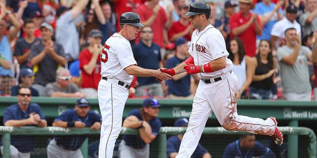 BOSTON, MA - AUGUST 1: Travis Shaw #47 of the Boston Red Sox celebrates with third base coach Brian Butterfield #55 of the Boston Red Sox after his second home run against the Tampa Bay Rays in the eighth inning at Fenway Park on August 1, 2015 in Boston, Massachusetts. (Photo by Jim Rogash/Getty Images)