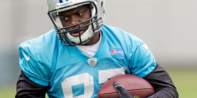 In this June 4, 2015, photo Carolina Panthers' Stephen Hill runs after a catch during an NFL football organized team activity in Charlotte, N.C. Hill has been cited for knowingly possessing drug paraphernalia with intent to use. Concord Police Department records indicate Hill was cited Tuesday near Charlotte Motor Speedway for possessing two grinders with marijuana residue and a marijuana bowl used to process, prepare and store. Panthers players are scheduled to arrive for training camp on Thursday. (AP Photo/Chuck Burton)