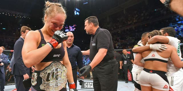 RIO DE JANEIRO, BRAZIL - AUGUST 01: (L-R) Ronda Rousey of the United States celebrates her knock out victory over Bethe Correia of Brazil in the first round in their UFC women's bantamweight championship bout during the UFC 190 event inside HSBC Arena on August 1, 2015 in Rio de Janeiro, Brazil. (Photo by Josh Hedges/Zuffa LLC/Zuffa LLC via Getty Images)