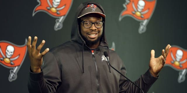 Tampa Bay Buccaneers defensive tackle Gerald McCoy gestures while speaking to reporters during an NFL football training camp news conference Saturday, Aug. 1, 2015, in Tampa, Fla. The first day of the team's training camp was canceled due to inclement weather. (AP Photo/Chris O'Meara)