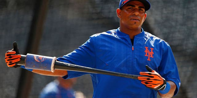 NEW YORK, NY - AUGUST 1: Yoenis Cespedes #52 of the New York Mets during batting practice before a game against the Washington Nationals on August 1, 2015 at Citi Field in the Flushing neighborhood of the Queens borough of New York City. (Photo by Rich Schultz/Getty Images)