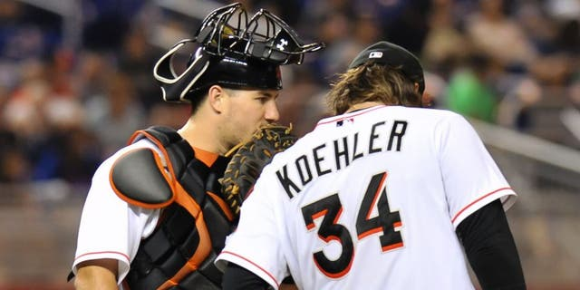 Aug 3, 2015; Miami, FL, USA; Miami Marlins catcher J.T. Realmuto (left) talks with starting pitcher Tom Koehler (right) on the pitchers mound during the fourth inning against the New York Mets at Marlins Park. Mandatory Credit: Steve Mitchell-USA TODAY Sports