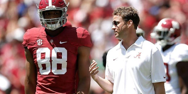 TUSCALOOSA, AL - APRIL 19: Offensive coordinator Lane Kiffin of the Alabama Crimson Tide speaks with O.J. Howard #88 of the Crimson team during the University of Alabama A-Day spring game at Bryant-Denny Stadium on April 19, 2014 in Tuscaloosa, Alabama. (Photo by Stacy Revere/Getty Images)
