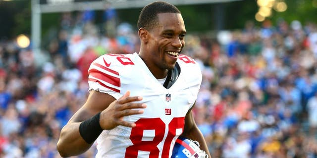 Aug 3, 2014; Canton, OH, USA; New York Giants wide receiver Victor Cruz (80) reacts prior to the 2014 Pro Football Hall of Fame game against the Buffalo Bills at Fawcett Stadium. Mandatory Credit: Andrew Weber-USA TODAY Sports