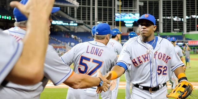 Aug 4, 2015; Miami, FL, USA; New York Mets left fielder Yoenis Cespedes (52) celebrates with teammates after defatting the Miami Marlins 5-1 at Marlins Park. Mandatory Credit: Steve Mitchell-USA TODAY Sports