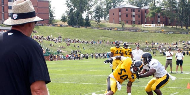 Pittsburgh Steelers defensive coordinator Keith Butler, left, watches as inside linebacker Ryan Shazier (50) works on running back Cameron Stingly during a drill at NFL football training camp, Wednesday, July 29, 2015, in Latrobe, Pa. (AP Photo/Keith Srakocic)
