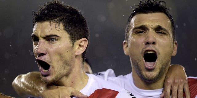 Argentina's River Plate Lucas Alario (L) celebrates with Nicolas Bertolo after scoring against Mexico's Tigres during their Libertadores Cup second leg final match at Americo Vespucio stadium, in Buenos Aires, on August 5, 2015. AFP PHOTO/JUAN MABROMATA (Photo credit should read JUAN MABROMATA/AFP/Getty Images)