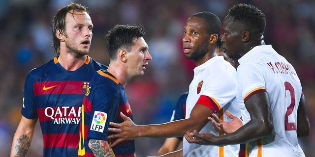 BARCELONA, SPAIN - AUGUST 05: Lionel Messi of FC Barcelona argues with Yanga-M'Biwa (R) of AS Romaduring the Joan Gamper trophy match at Camp Nou on August 5, 2015 in Barcelona, Spain. (Photo by David Ramos/Getty Images)