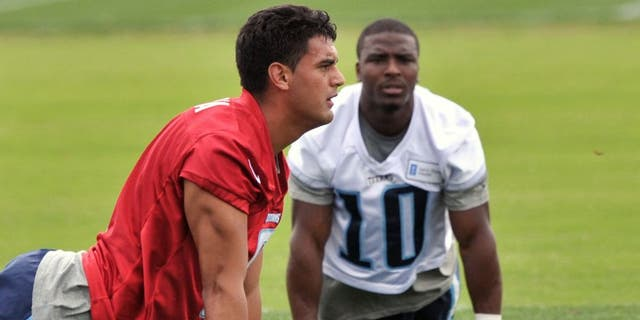 May 26, 2015; Nashville, TN, USA; Tennessee Titans first round draft pick quarterback Marcus Mariota (8) works out with titans wide receiver Jacoby Ford (10) during OTA at Saint Thomas Sports Park. Mandatory Credit: Jim Brown-USA TODAY Sports