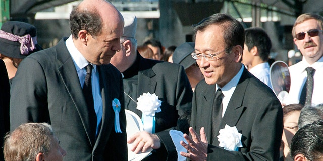Aug. 6: In this photo provided by the City of Hiroshima, U.S. Ambassador to Japan John Roos, center left, greets Hiroshima city's Mayor Tadatoshi Akiba on his arrival at the Hiroshima Peace Memorial Park to attend the 65th anniversary of the world's first atomic bombing in Hiroshima. The United States sent its first ever delegation to the ceremony marking the anniversary of the attacks.