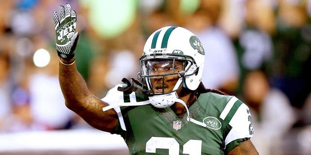 EAST RUTHERFORD, NJ - AUGUST 07: Running back Chris Johnson #21 of the New York Jets celebrates a touchdown against the Indianapolis Colts in the second quarter during a preseason game at MetLife Stadium on August 7, 2014 in East Rutherford, New Jersey. (Photo by Elsa/Getty Images)