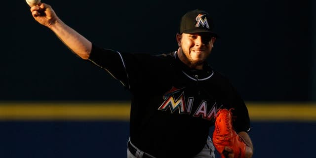 Miami Marlins starting pitcher Jose Fernandez throws during the first inning of the Marlins' baseball game against the Atlanta Braves, Friday, Aug. 7, 2015, in Atlanta. (AP Photo/Brett Davis)