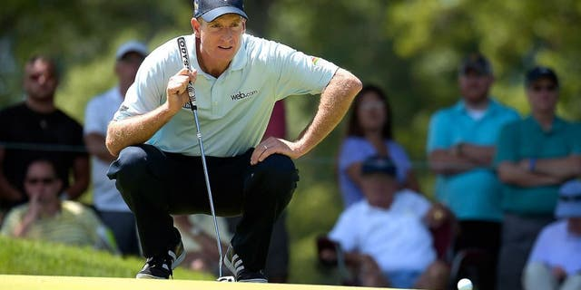 AKRON, OH - AUGUST 07: Jim Furyk studies his putt on the third hole during the second round of the World Golf Championships-Bridgestone Invitational at Firestone Country Club on August 7, 2015 in Akron, Ohio. (Photo by Stan Badz/PGA TOUR)