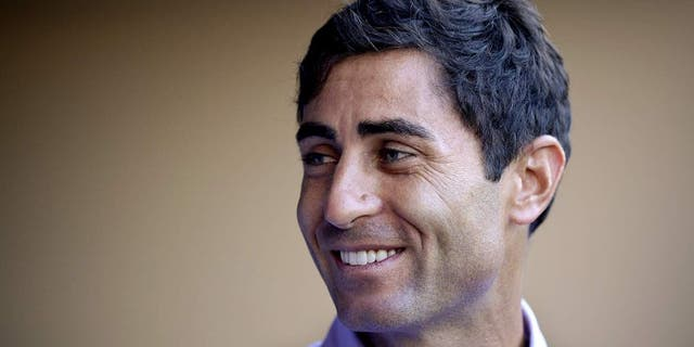 SAN DIEGO, CA - AUGUST 26: AJ Preller of the San Diego Padres visits the dugout prior to the game against the Milwaukee Brewers at Petco Park on August 26, 2014 in San Diego, California. (Photo by Andy Hayt/San Diego Padres/Getty Images) *** Local Caption *** AJ Preller