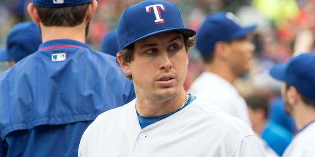 May 15, 2015; Arlington, TX, USA; Texas Rangers starting pitcher Derek Holland (45) before the game against the Cleveland Indians at Globe Life Park in Arlington. Mandatory Credit: Jerome Miron-USA TODAY Sports