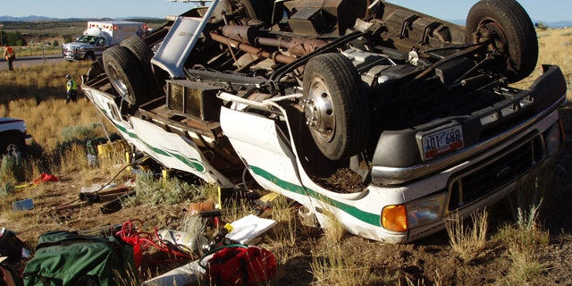 This Aug. 9, 2010 photo released by the Utah Highway Patrol shows a vehicle at the scene of a crash north of Cedar City, Utah where authorities say a tour bus carrying Japanese sightseers from Las Vegas to a national park in Utah crashed on Interstate 15. Utah Highway Patrol spokesman Cameron Roden says the bus was heading to Bryce Canyon National Park when it veered into a median and rolled over. (AP Photo/Utah Highway Patrol)