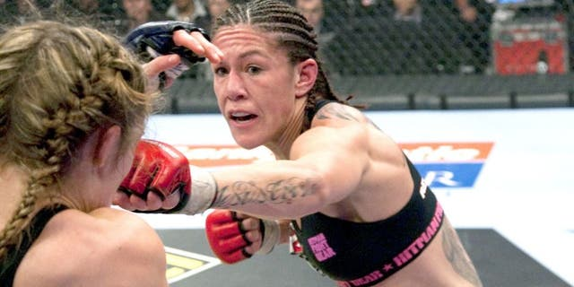 """SUNRISE, FL - JANUARY 30: (R-L) Cristiane """"Cyborg"""" Santos punches Marloes Coenen during the Women's Featherweight Championship bout at the Strikeforce Miami event on January 30, 2010 in Sunrise, Florida. (Photo by Esther Lin/Forza LLC/Forza LLC via Getty Images)"""