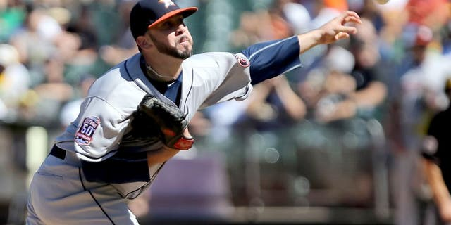 Aug 9, 2015; Oakland, CA, USA; Houston Astros relief pitcher Oliver Perez (38) pitches the ball against the Oakland Athletics during the seventh inning at O.co Coliseum. Mandatory Credit: Kelley L Cox-USA TODAY Sports