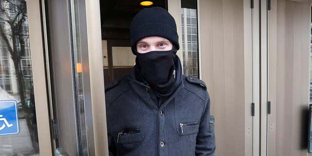 In this Feb. 2, 2016, photo, Aaron Driver leaves the Law Courts in Winnipeg, Manitoba.