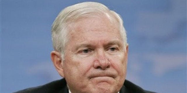 Aug. 9: Secretary of Defense Robert Gates pauses during a news conference at the Pentagon in Washington where he announced the cuts (AP).