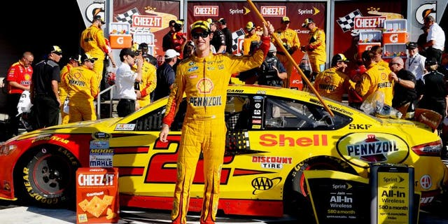 WATKINS GLEN, NY - AUGUST 09: Joey Logano, driver of the #22 Shell Pennzoil Ford, celebrates in victory lane after winning the NASCAR Sprint Cup Series Cheez-It 355 at the Glen at Watkins Glen International on August 9, 2015 in Watkins Glen, New York. (Photo by Robert Laberge/NASCAR via Getty Images)