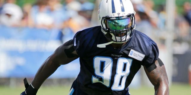 Tennessee Titans linebacker Brian Orakpo practices during NFL football training camp Saturday, Aug. 1, 2015, in Nashville, Tenn. Orakpo says he feels nimble and healthy thanks to breaking down, then revamping, a workout routine the three-time Pro Bowl linebacker believes led him to tear his pectoral muscle not just once or twice but three times. (AP Photo/Mark Humphrey)