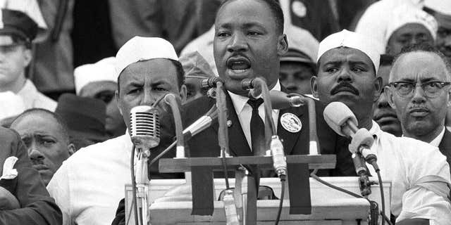 """Aug. 28, 1963: The Rev. Dr. Martin Luther King Jr., head of the Southern Christian Leadership Conference, gestures during his """"I Have a Dream"""" speech as he addresses thousands of civil rights supporters gathered in Washington, D.C."""