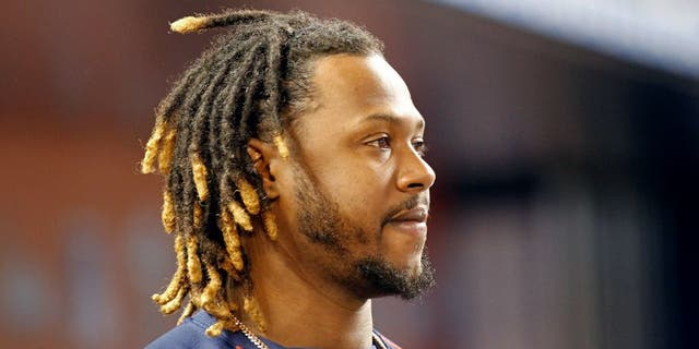 MIAMI, FL - AUGUST 11: Hanley Ramirez #13 of the Boston Red Sox stands in the dugout as the Red Sox played the Miami Marlins at Marlins Park on August 11, 2015 in Miami, Florida. (Photo by Joe Skipper/Getty Images)