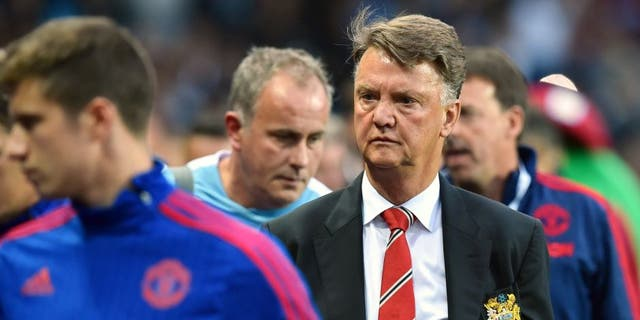Manchester United's Dutch manager Louis van Gaal (2nd R) arrives for the start of the English Premier League football match between Aston Villa and Manchester United at Villa Park in Birmingham, central England, on August 14, 2015. AFP PHOTO / BEN STANSALL RESTRICTED TO EDITORIAL USE. No use with unauthorized audio, video, data, fixture lists, club/league logos or 'live' services. Online in-match use limited to 75 images, no video emulation. No use in betting, games or single club/league/player publications. (Photo credit should read BEN STANSALL/AFP/Getty Images)