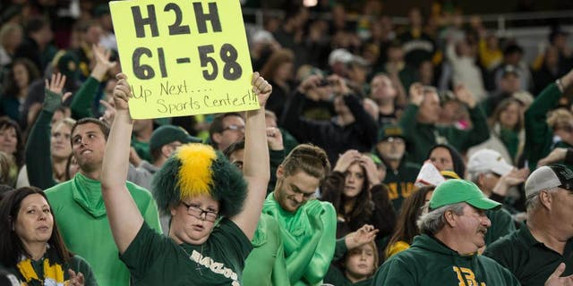 Dec 6, 2014; Waco, TX, USA; A Baylor Bears fan holds up a sign with the October score of the Bears game against the TCU Horned Frogs during the second half of the game between the Bears and the Kansas State Wildcats at McLane Stadium. The Bears defeated the Wildcats 38-27. Mandatory Credit: Jerome Miron-USA TODAY Sports